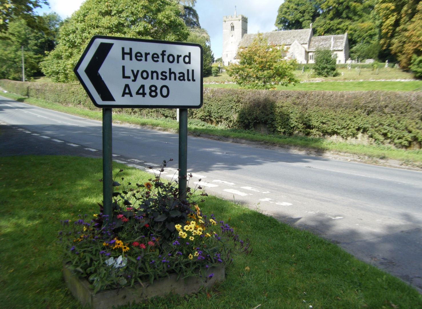 Lyonshall church and roadsign